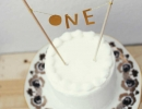 DIY delicate feather cake topper | 10 1st Birthday Party Ideas for Boys Part 2 - Tinyme Blog