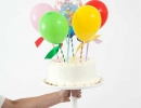 Happy balloon pop kits are sure to make any cake look divine. | 10 Adorable Cake Toppers Part 3 - Tinyme Blog