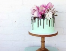 Love this chocolate drip cake with fresh magnolia flowers | 10 Amazing Drip Cakes - Tinyme Blog