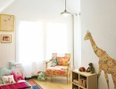 Whimsical playroom with floral giraffe wall decal | 10 Animal inspired Kids Bedrooms - Tinyme Blog