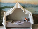 Lovely touches of tent bed and play campfire create a wonderland for your kids | 10 Camp Themed Bedrooms - Tinyme Blog