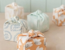 Oh-so-sweet knotted fabric-wrapped favor boxes | 10 Cute and Creative Gift Wrapping ideas - Tinyme Blog