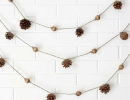 Delicate and earthy wooden bead garland with pine cone | 10 Cute Christmas Crafts - Tinyme Blog
