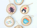 Whimsical birch rounds with quirky art prints | 10 Cute Christmas Ornaments - Tinyme Blog