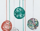 Sculpted Yarn Balls | 10 DIY Baby Mobiles - Tinyme Blog