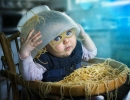 Baby with spaghetti over head | 10 Funny Toddler Moments - Tinyme Blog