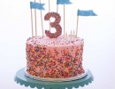 The perfect birthday cake with adorable flags! | 10 Super Sprinkles Cakes - Tinyme Blog